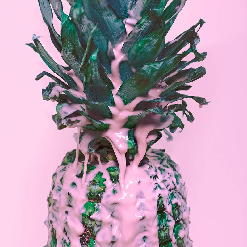 Pineapple with pink paint dripping over top of it - Airdrie Paint and Decor