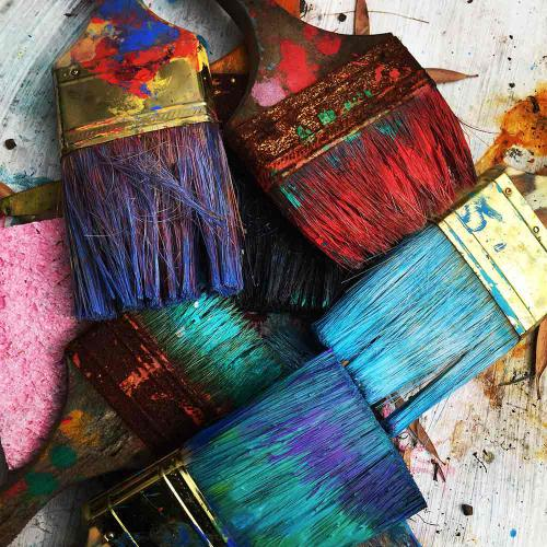 Old colourful used paint brushes - Airdrie Paint and Decor
