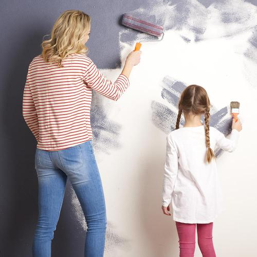 Family Painting a wall - Airdrie Paint and Decor