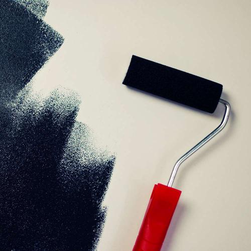 Roller putting paint on a wall - Airdrie Paint and Decor